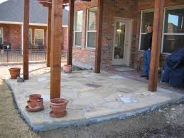extended existing patio with flagstone patio patterned concrete