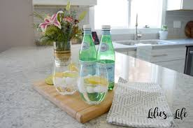 lg viatera everest white quartz countertops with flowers and cutting board
