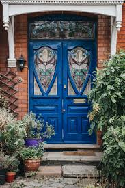 wood front door with stained glass windows
