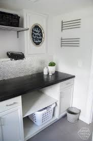 i love this laundry room makeover i can t believe those countertops are wood