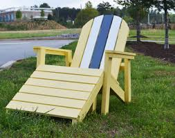 amazing plastic adirondack chairs home depot with green grass and tall green trees plus stone pavers viewing gallery