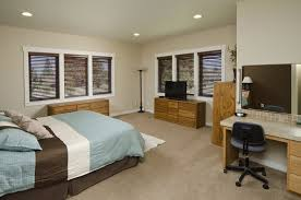 this bedroom features stained wood cabinets and drawers with a defining wood grain the room