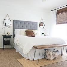 I love this room update by /whitneyhoulin/ and the bench at the end of her  bed would be such a fun DIY!