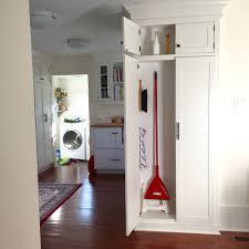 image of white broom closet cabinet