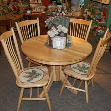 42 round tribeca hickory dining table with 4 easton shaker side chairs shown in hickory with a natural finish