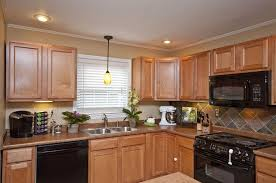 sweet yellow kitchen lighting over sink feat cool black kitchen appliance set design plus awesome kitchens lighting