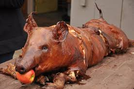 Image result for roasted pig with apple in mouth pictures