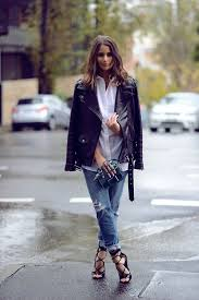 opt for comfort in a black leather biker jacket and blue distressed boyfriend jeans finish