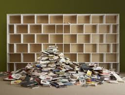 the nonfiction battle royal between books and essays the  pile of books by empty shelves photo for local living illustration