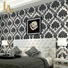 luxurious damask themed bedroom decor with vinyl wallpaper and white tufted bed
