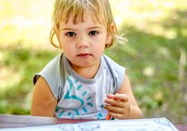 Small Picture Beautiful Two year old girl drawing in a coloring book Stock