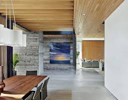 board form concrete walls mix well with glasetal in modern house designs
