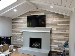 pallet wood wall fireplace. distressed build wood pallet wall- make new look old, aged, weathered, wall fireplace