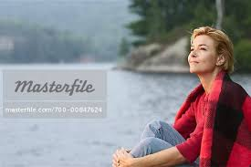 Woman Sitting Beside Lake - Stock Photo - Masterfile - Rights-Managed,  Artist: Marc Vaughn, Code: 700-00847624