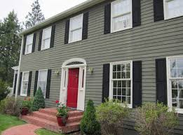 how to paint your house with green wall color theme with white windows frame