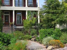 Minimalist Tetured Tiles Front Yard Curb Appeal Ideas With Green Plants And  Black Painted Iron Fence