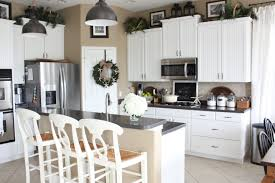 shiplap wall kitchen. the white painted shiplap wall balances out beadboard kitchen cabinets on other side of room, which gives our big space a light, bright,