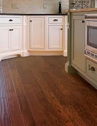 home legend s hickory collection features north american hardwood with distressed and hand sed finishes