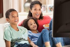 family watching tv at night. family watching tv at night