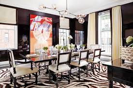 nyc apartment gets a glamorous update from zebra print rug black tan dining room gold