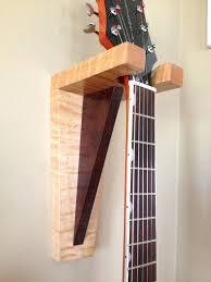multiple guitar wall hanger ideas hercules wall mount guitar stand gsp38wb guitar wall hooks ideas guitar wall hanger