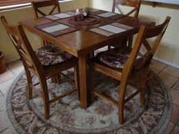image of rug under round dining table pads