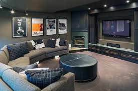 Basement movie theater family room transitional with wall mounted tv