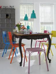 Mixing chair color in the dining room crosses all styles and is  refreshingly anti-neutral.