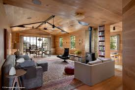 rare laver kirman antique rugs compliment a beautiful modern living room with industrial beams