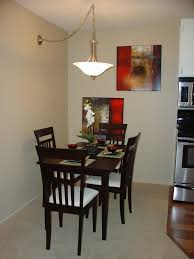 small dining room furniture ideas. Small, Square Table. Elevated Dining Area With Wall Paintings Small Room Furniture Ideas
