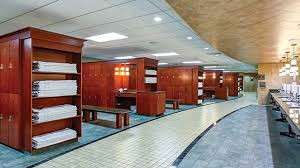 luxurious spa inspired locker room with stacks of plimentary towels available