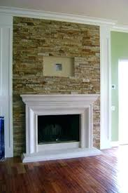 tv mounted above brick fireplace fireplce hng bove wall mount into
