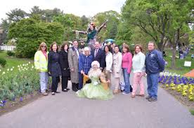 fairies from the national circus project at the clark garden spring festival pose with local officials