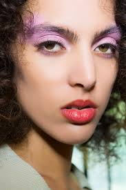 pink eyeshadow and muted red lipstick