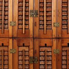 a lovely pair of antique wooden shutters salvaged from a house in nashville tn and dating from the 1930 s these interior shutters are stained a lovely