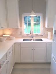 kitchen sinks and pendant lights on with in over sink