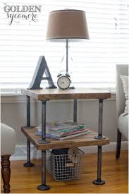 Industrial diy side table with steel pipe and unique desk lamp next to  alarm clock