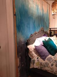 painted canvas drop cloth in hues of turquoise temporary choice instead of painting the walls