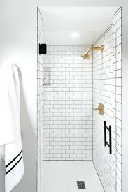 white subway tile with gray grout white subway shower tiles with gray grout and brushed gold