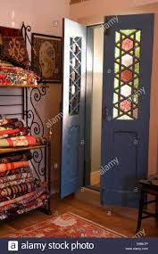 glass double door. Black Double Doors With Stained Glass Panels In Small Hall Folded Rugs On Metal Shelves Door D