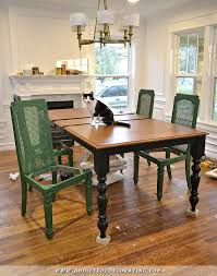 dining table and chairs progress black farmhouse table with green cane back chairs