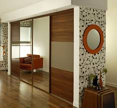 modern mirrored fitted wardrobes with sliding glass door design for contemporary bedroom interior decoration ideas