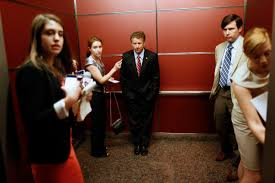 people in elevator. rand paul rides in an elevator with people