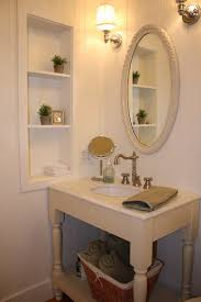 bathroom breathtaking decoration using oval metal frame furniture mirror including round white undermount sinks and wood