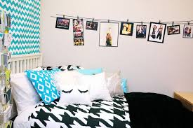 a string full of photos and a color theme for your room diy