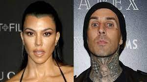 Kourtney Kardashian Sits on Travis ...