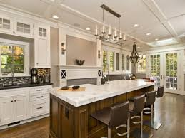 Cool And Charming White Marble Tops Kitchen Island With Seating Black  Leather Seat Stools And White Modern Kitchen Cabinetry Set In Open Plan  Kitchen Areas ...