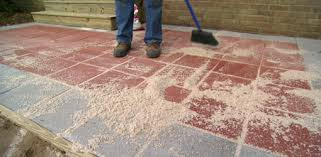 sweeping sand between pavers