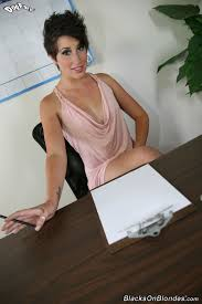 Black Secretary Nicole Nowak with Tattoo Wearing Pink Dress in.