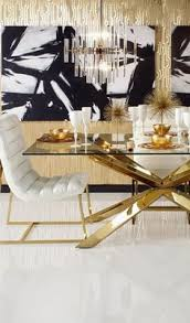 gold white and black hollywood regency style dining room